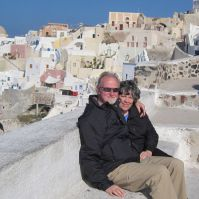 Terri & James perched above Oia Santorini on our most recent RTW. https://gallivance.net/2011/12/02/the-rocky-road-to-athens/