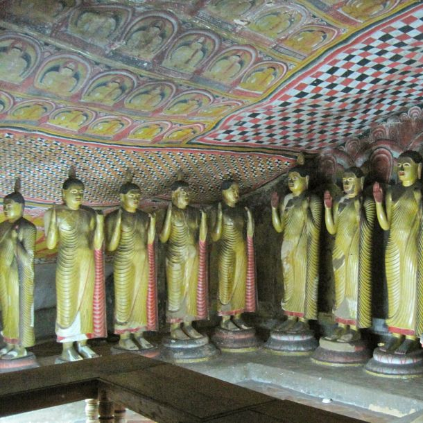 Intricately painted ceiling of a Buddhist cave temple in Dambulla, Sri Lanka