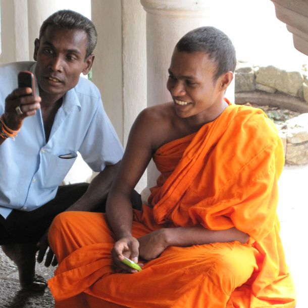 Monk with Phone