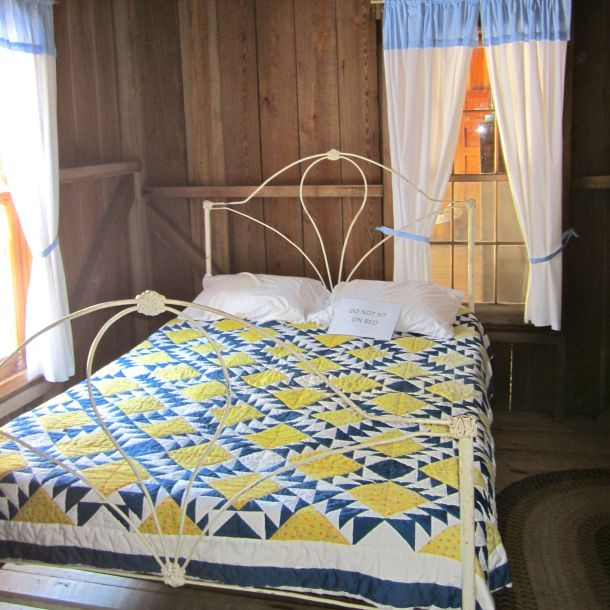 Bed w Blue Quilt
