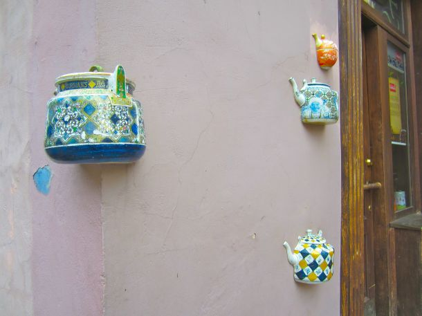 Teapots on wall