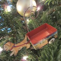 Puppy Wagon. The old-timey innocence of this ornament is what I love. It makes me think of my sister Sue who was great at getting our dog Katie to push or pull her around in any vehicle!