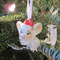Topo Gigio. I stumbled across this tiny Christmas mouse in a St. Augustine antique shop and knew it was coming home with me.