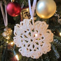 Mom's Snowflake. My Mother was a wizard with a crochet hook. She created sets of these lacy snowflakes for all the Sisters.