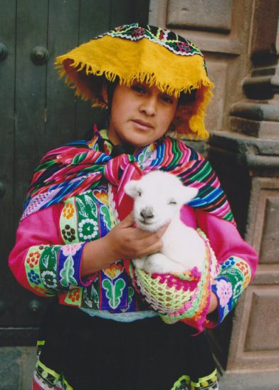 Indian_girl_with_a_young_alpaca_in_Peru