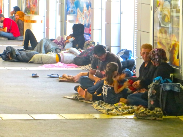 Refugees line walls of Belgrade bus station