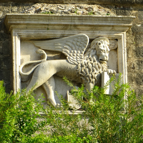 The winged lion of St Mark, Venice's symbol from when the town was under Venetian rule (1420–1797).