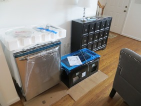 New microwave and dishwasher ready to install.