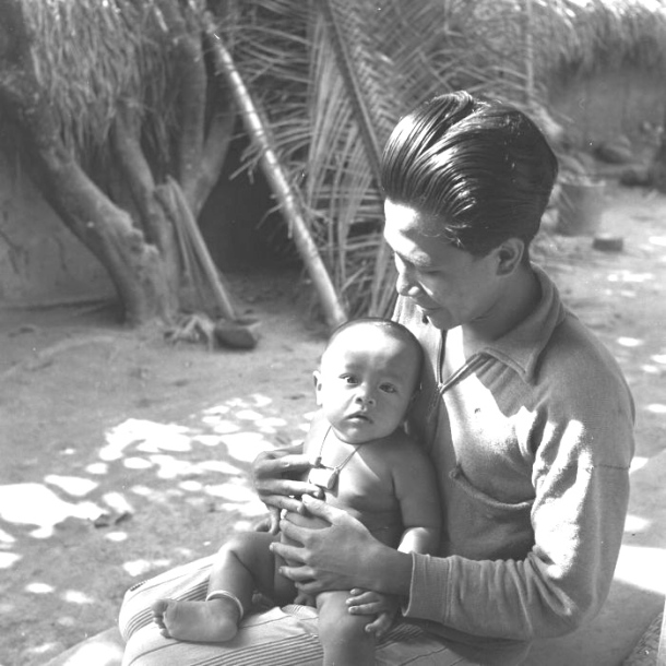 Balinese father and baby