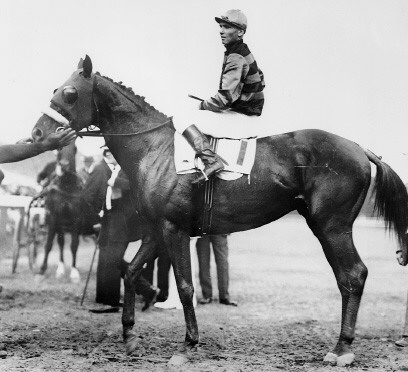 Sir Barton and jockey Johnny Loftus, 1919 Preakness Stakes.