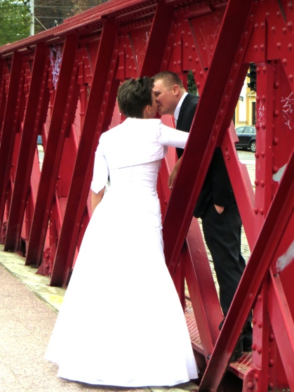 Cute couple kissing on the bridge in Wroclaw.