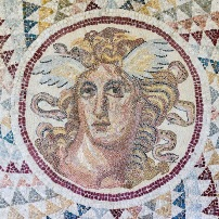 Floor mosaic, detail of the gorgone Medusa, opus tessellatum, found in Zea (Piraeus). 2nd century CE.