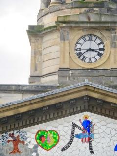 Green heart in building pediment. Glasgow, Scotland